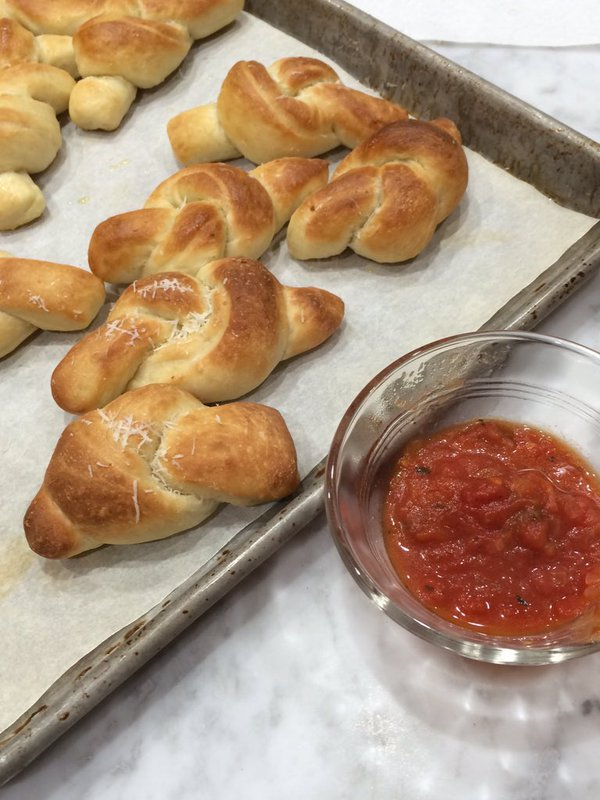 homemade garlic knots, made from a minimally kneaded New York style pizza dough